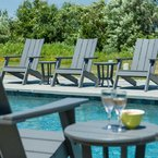 Modern Adirondack chairs made from enviro-wood, available in 18 colours, at the pool area