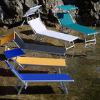 Aluminium sunbeds with sunshield, anodized, fabrics available in various colours, in a beach club
