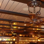 Americana ceiling fan, antique brass finish, with wooden blades in tropical-colonial style