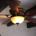 Ventana ceiling fan, sedona beige finish, with wooden blades and amber glass bowl in colonial style