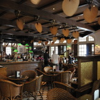 Punkah ceiling fan in tropical-colonial style, antique brass with natural palm leaf blades, Raffles Hotel Singapore
